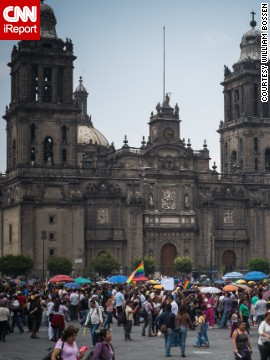 Mexico City's gay pride parade draws thousands of people each June, like this gathering at the Presidential Palace and the Cathedral of the Americas.