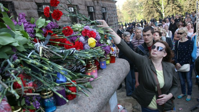 People lay flowers and candles at the burned trade union building in Odessa on May 3.
