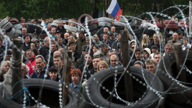 Pro-Russian protesters gather in Donetsk to honor the memory of comrades who died in Odessa.