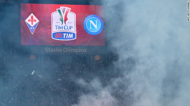 Smoke rises over Rome's Olympic Stadium before the Italian Cup Final. Napoli's ultra