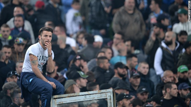 The start of the final between Napoli and Fiorentina was delayed after violence followed local reports that several fans had been shot.