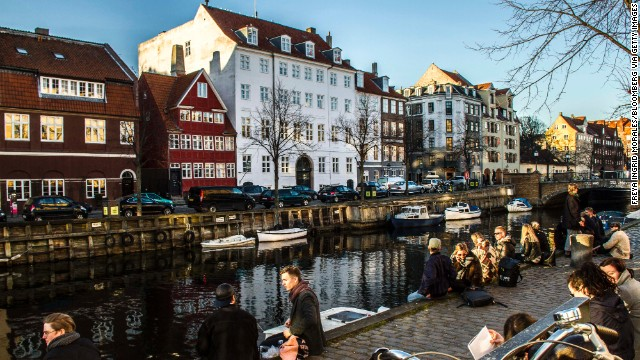 Pedestrians enjoy the weather in the Christians Havn district of Copenhagen, <strong>Denmark</strong>. The Danes enjoy the best work-life balance of all OECD countries, and also rank at the top in social connections. Denmark comes in at number four on the OECD list.<!-- --> </br>