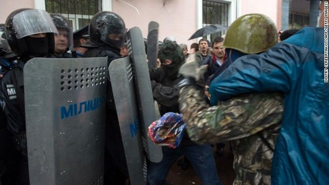 Pro-Russian militants clash with police as they storm the police station in Odessa on May 4.