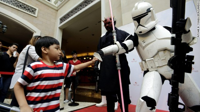 "A child fist-bumps a Stormtrooper during ""Star Wars Day"" celebrations at Pasay City, Philippines."