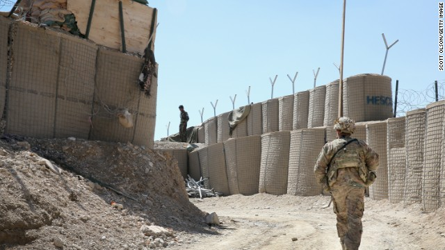 A U.S. soldier patrols outside FOB Shank In Afghanistan.