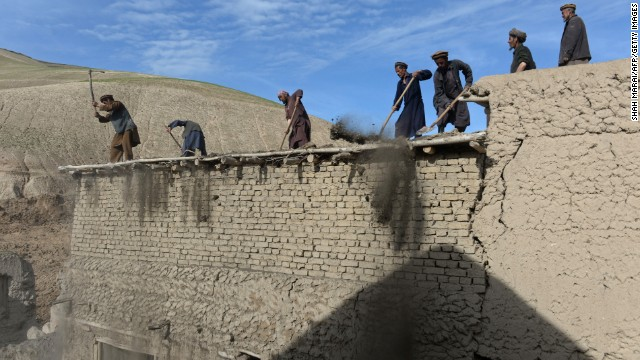 Villagers break down a damaged house on May 4.