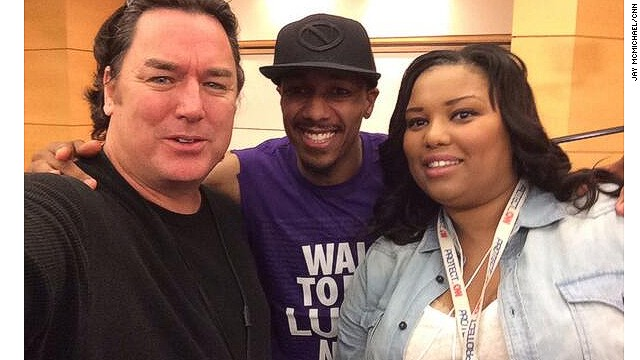 Lauren Lee-Johnson and CNN photojournalist Jay McMichael take a selfie with Nick Cannon at the Walk to End Lupus Now event.
