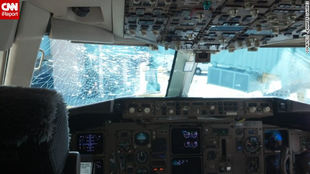 A CNN iReporter caught this picture of her airplane's damaged windshield after landing.
