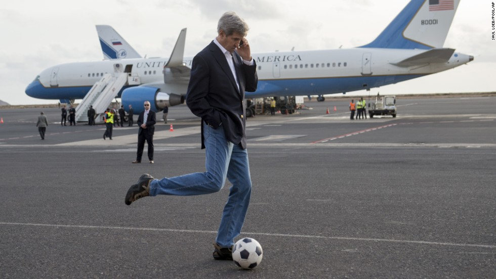 U.S. Secretary of State John Kerry kicks around a soccer ball during an airplane refueling stop at Sal Island, Cape Verde, on Monday, May 5. Kerry was on his first major tour of Africa, focusing on some of the continent's most brutal conflicts.