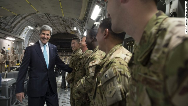 Kerry talks with the crew of a U.S. Air Force plane prior to departure from Addis Ababa, Ethiopia, on Friday, May 2. He was en route to Juba, South Sudan, to demand a cease-fire in the brutal civil war that has sparked dire warnings of genocide and famine.