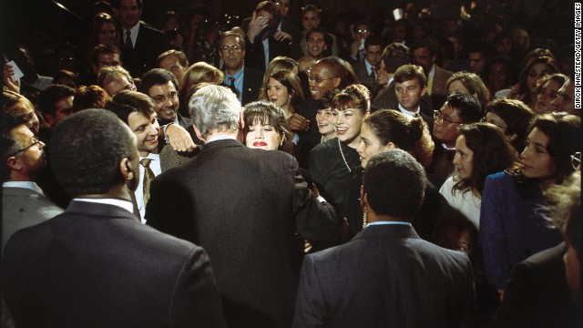 Monica Lewinsky embraces U.S. President Bill Clinton at a Democratic fundraiser in Washington in October 1996. Lewinsky, the White House intern who had a sexual relationship with Clinton during his time in office, has finally broken her silence on the affair in a Vanity Fair article.