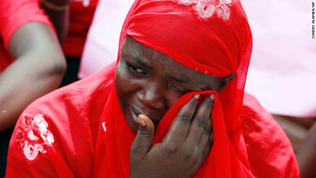A woman attends a demonstration Tuesday, May 6, that called for the Nigerian government to rescue nearly 300 schoolgirls who were kidnapped last month in Chibok, Nigeria. The girls were taken by the Islamist militant group Boko Haram.