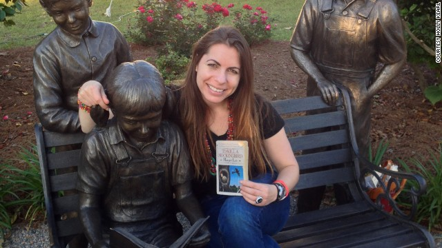 "In 2014, Kearl visited her 50th state -- Alabama. Here she poses with a tribute statue to Harper Lee's ""To Kill a Mockingbird"" in Monroeville."