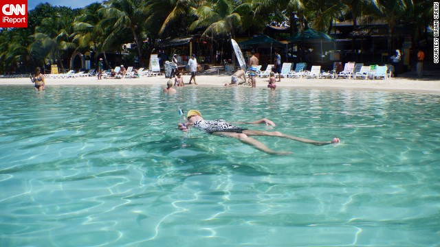 "<a href='http://ireport.cnn.com/docs/DOC-1082995'>Brian Crews</a> says the water at West Bay Beach in Roatan, Honduras, was really that clear ""and looked even better in person."""