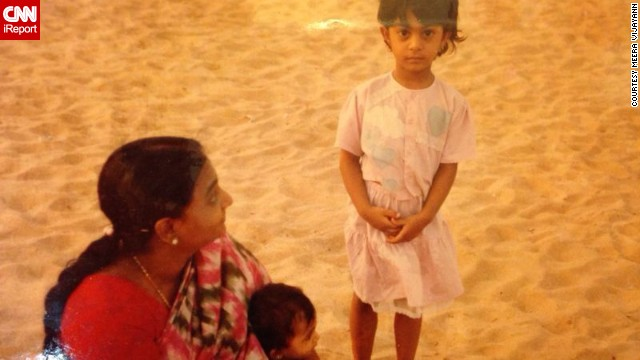"Indian iReporter <a href='http://ireport.cnn.com/docs/DOC-1126772'>Meera Vijayann</a>, pictured standing next to her grandmother and younger sister, spent much of her childhood in Kollam, a small port town along the country's southern coast. As a young girl she was brought up to respect her elders, a common occurrence within Indian culture. As a result, she developed a deep bond with her grandmother. She explains: ""As a child, she was my source of strength, a vision of wisdom and womanhood so powerful..."""