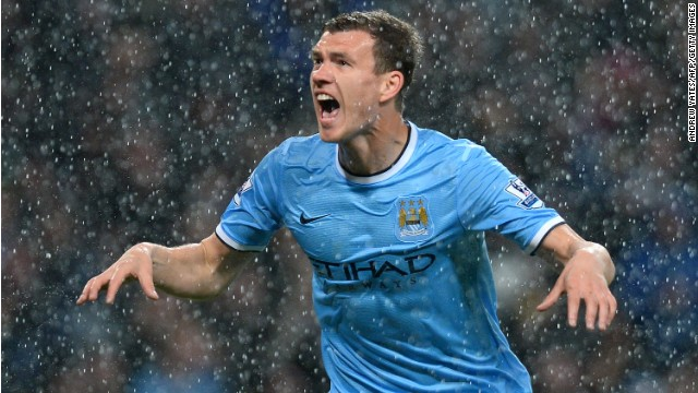 Edin Dzeko scored twice as Manchester City moved to within touching distance of the Premier League title.