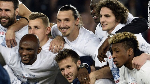 PSG's players celebrate after clinching the league title for the second season in succession.