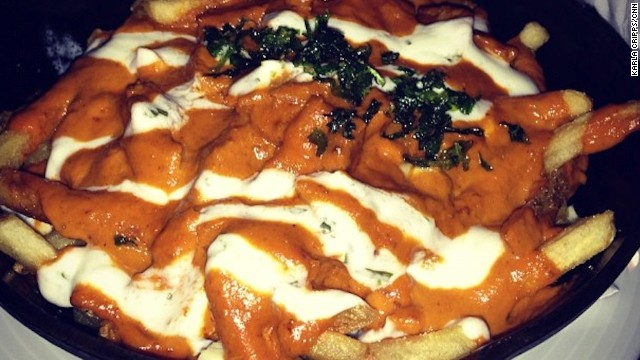 """This butter chicken poutine was served at a pub in Canada's Fairmont Chateau Lake Louise hotel. The photographer reports: """"Looks so wrong, tastes so right."""""""