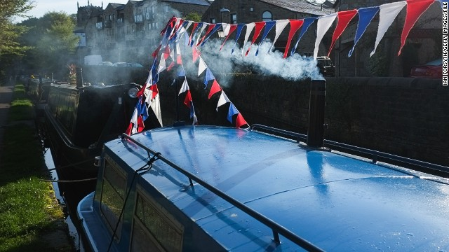 """""""If you were to see us sitting on the front deck of a narrowboat on a sunny day with a glass of wine, a cheeseboard, nice music in the background, the sun going down and the mist coming up, yes that's romantic and lovely,"""" says Wildman."""