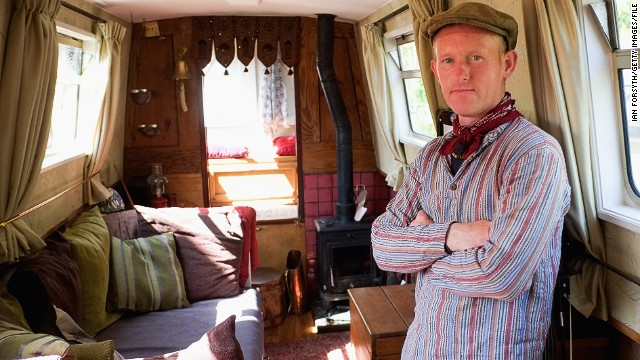 A boat owner offers a sneak peek inside his floating home as part of a three-day Waterway Festival held between the British cities of Leeds and Liverpool.