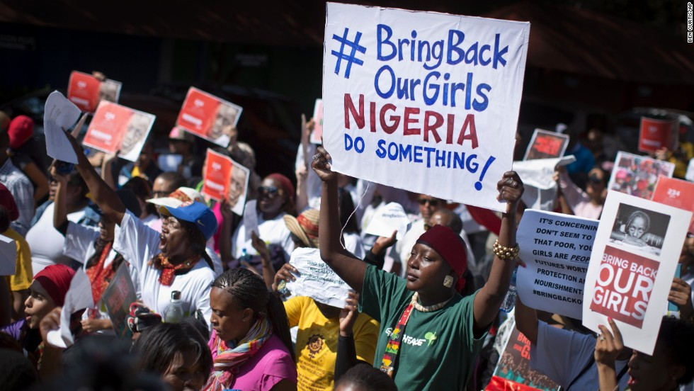 "During a march to the Nigerian Consulate in Johannesburg on Thursday, May 8, protesters call for the Nigerian government to rescue nearly 300 schoolgirls who were kidnapped last month in Chibok, Nigeria. The girls were taken by the Islamist militant group Boko Haram, which means ""Western education is sin,"" and the abductions <a href='http://www.cnn.com/2014/05/01/world/gallery/nigeria-girls-kidnapped/index.html'>have sparked a global outcry</a>."