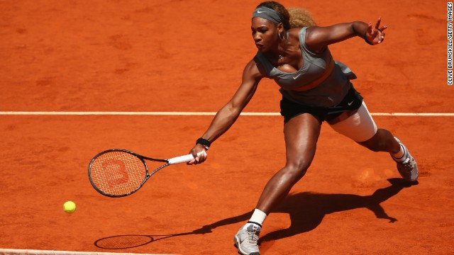 Serena Williams stretches to play a shot during her straight sets win over Carla Suarez Navarro of Spain.