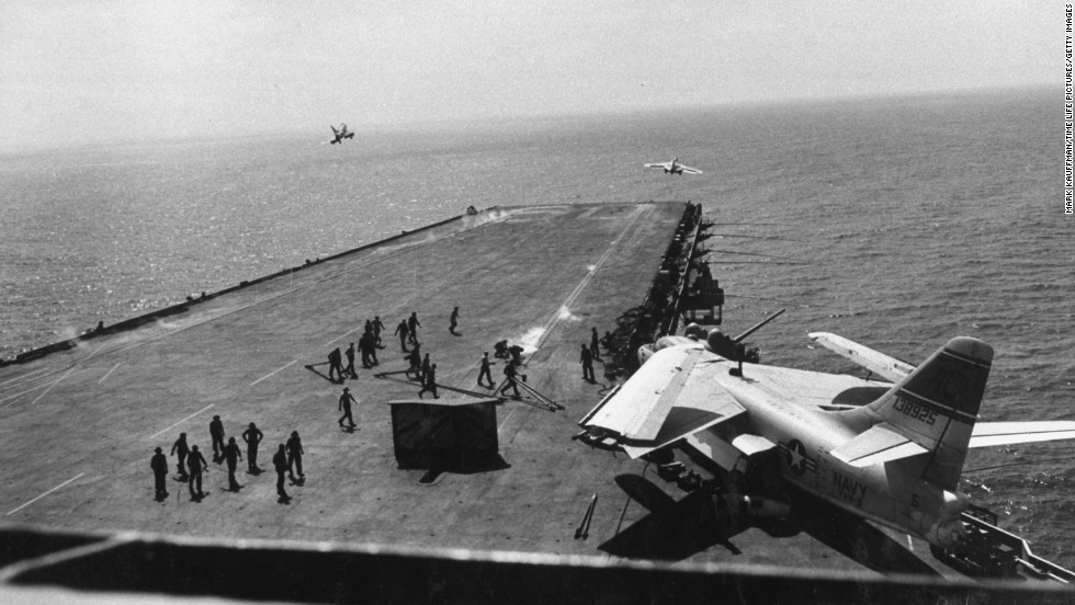 "A crew works from the deck of the USS Saratoga in 1958. The U.S. Navy has paid a Texas recycling company a penny to dispose of the Saratoga, part of the Forrestal-class of ""supercarrier"" vessels built for the Atomic Age. The carrier was decommissioned 20 years ago. Click through the gallery to see photos of other carrier classes throughout American history:"