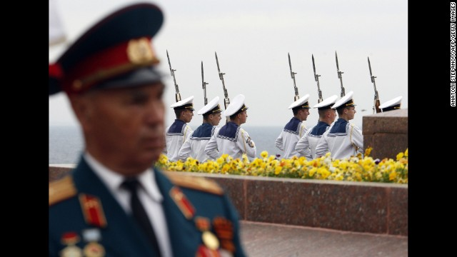 Sailors take part in a Victory Day ceremony at the Unknown Sailor Memorial in Odessa, Ukraine.