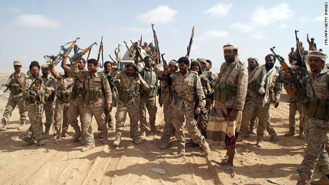 Soldiers brandish their weapons as they take part in an offensive against extremists Wednesday in Shabwa province, Yemen.