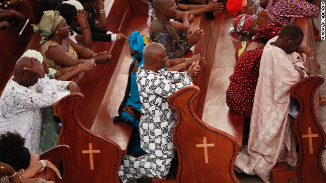 Catholic faithful attend a morning Mass in honor of the kidnapped Chibok schoolgirls, in Abuja, Nigeria, on May 11.