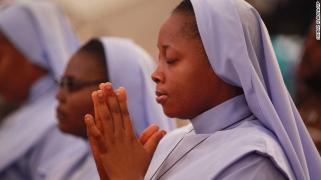 Catholics nuns pray during a morning Mass in honor of the kidnapped Chibok schoolgirls, in Abuja, Nigeria, on May 11.