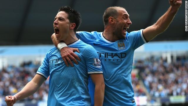 Samir Nasri (left) and Pablo Zabaleta celebrate after Nasri scores against West Ham United.