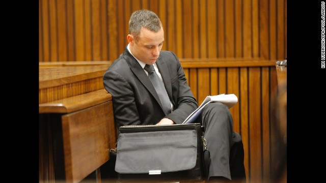 Oscar Pistorius reads notes during his trial on Monday, May 12.