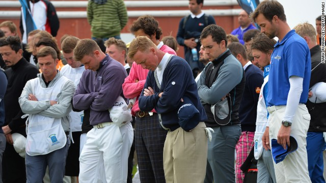Players and caddies observe a minute's silence for Iain McGregor following his death at the Madeira Islands Open.