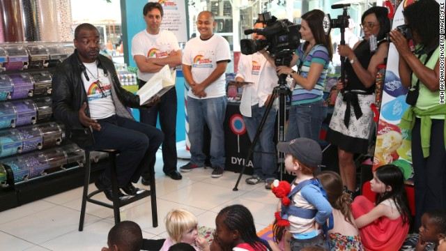 "Burton reads to children during the ""Reading Rainbow's"" 30th anniversary celebration in Los Angeles in June 2013."