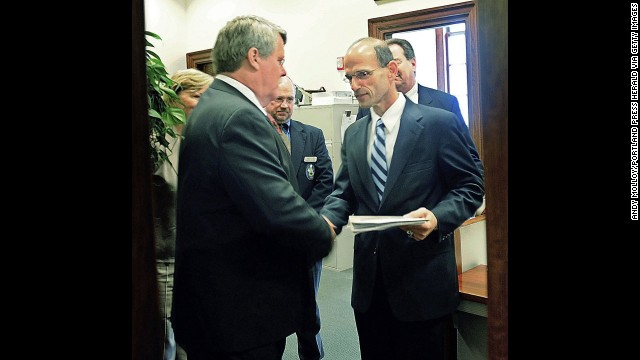 Maine state Sen. Dennis Damon, left, hands Gov. John Baldacci the bill that the state Senate passed in May 2009 to affirm the right of same-sex couples to marry.