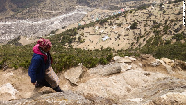 Ang Riku climbs the steep hills above Thamo to reach three isolated monasteries where she'll ask lamas to pray for her husband's afterlife and reincarnation.