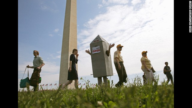Steven Avilla wears a Washington Monument costume as he greets visitors.