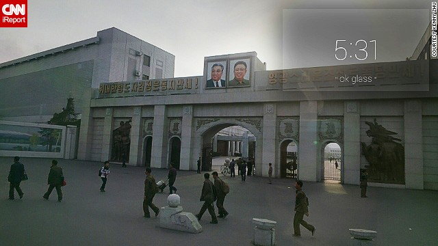 "The words beside the two photos translate roughly as ""Long live the The Great Leader Kim Jong-un,"" and ""Long Live the Sun-Like Workers' Party of Korea."""
