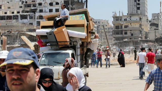 Residents return to the Old City of Homs, Syria, on Monday, May 12, 2014. A truce between the Syrian government and rebel forces in the strategic and symbolic city <a href='http://www.cnn.com/2014/05/07/world/meast/syria-truce-explain/index.html'>has gone into effect</a>, allowing many of its residents to come home for the first time in nearly two years. Homs has experienced some of the worst of the violence in <a href='http://www.cnn.com/2013/08/27/world/meast/syria-civil-war-fast-facts/index.html'>a bloody civil war</a> that has left more than 100,000 people dead and driven millions of people from their homes across the country.