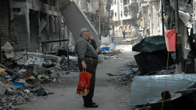 A resident surveys a damaged building in the Hamidiyeh neighborhood on May 9.