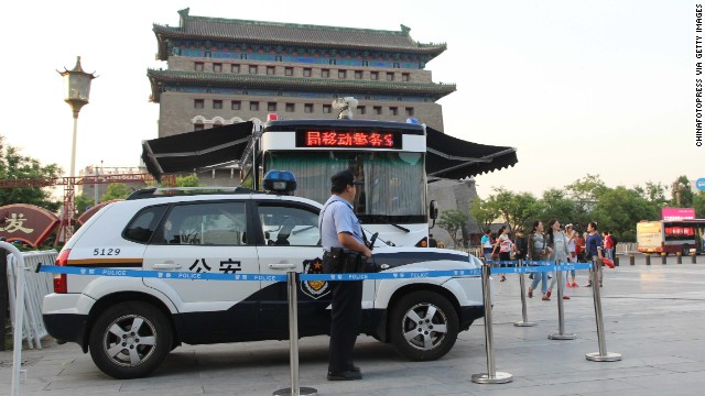 An armed police officer stands guard in Beijing on May 12, 2014 amid greater scrutiny on security in China's capital.