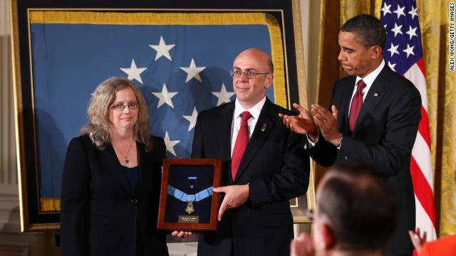 Phil and Maureen Miller receive the Medal of Honor on behalf of their son, Army Staff Sgt. Robert J. Miller, on October 6, 2010. The soldier was cited for engaging more than 100 enemy fighters in the Gowardesh Valley, Afghanistan, on January 25, 2008. Miller killed 10 of the enemy and wounded dozens more before being mortally wounded by enemy fire.