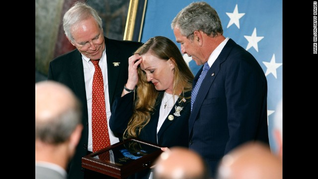 President George W. Bush presents the Medal of Honor to Daniel and Maureen Murphy, parents of Navy Lt. Michael Murphy, on October 22, 2007. Murphy, a Navy SEAL, was killed June 28, 2005, when his four-man team was assaulted by 30 to 40 enemy fighters. Murphy exposed himself to repeated enemy fire while trying to radio for help for his besieged team, his citation said.