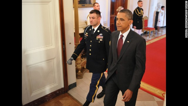 President Obama walks with Army Sgt. 1st Class Leroy Arthur Petry, who received the Medal of Honor on July 12, 2011. Petry was cited for his actions during a battle in Paktya province, Afghanistan, on May 26, 2008, which included picking up an enemy grenade thrown at him and fellow soldiers. As he was about to throw it away, the grenade exploded and blew off his right hand, according to his citation.