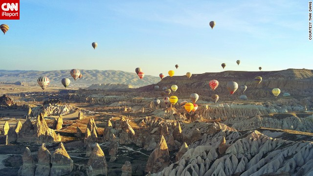 "A <a href='http://ireport.cnn.com/docs/DOC-1112806'>hot air balloon trip</a> is a popular way to take in the stunning views of Central Turkey's <a href='http://www.tanitma.gov.tr/TR,22529/tatil-yerleri-destinasyonlar.html' target='_blank'>Goreme National Park</a> and its unusual volcanic rock formations, known as ""fairy chimneys."""