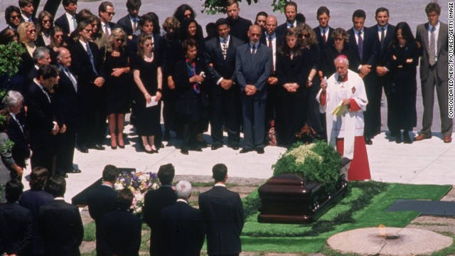 Jacqueline Kennedy Onassis is laid to rest beside her husband, John F Kennedy, at Arlington National Cemetery on May 23, 1994.