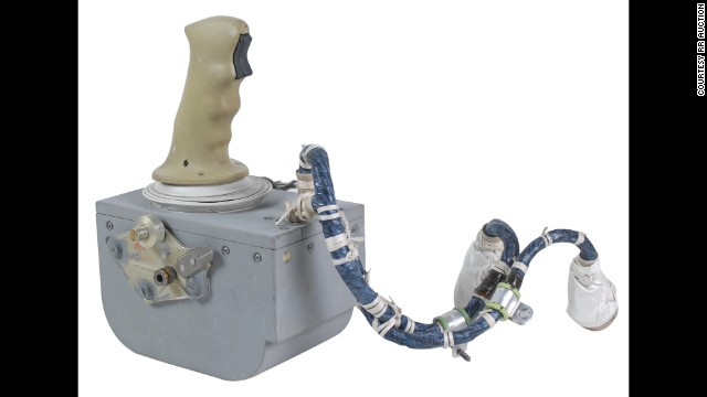 "Dozens of artifacts from Apollo lunar missions were auctioned off this week. Among them: This hand controller from the Apollo 15 Lunar Module ""Falcon,"" which was used by Commander Dave Scott to help land him and pilot James Irwin on the moon on July 30, 1971. It was bought by an anonymous European client for $610,063."