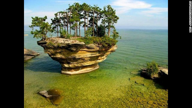 On a clear, sunny day at Lake Huron, the not romantically-named Turnip Rock in Michigan, will overcome its name.