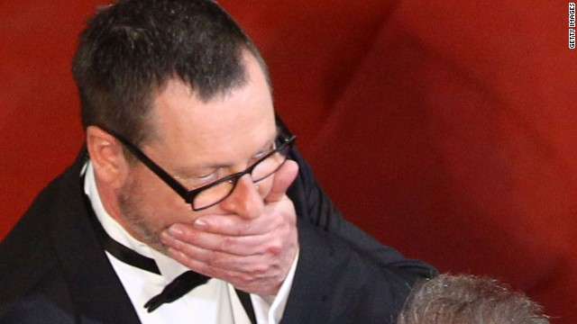 Lars von Trier claps his hand across his mouth at Cannes in 2011. Perhaps he is reliving the moment he sympathized with Hitler.
